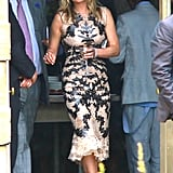 Kate Moss wore a formfitting dress.