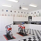 """This renovated garage space is more of a """"man cave"""" than a """"she shed,"""" but checked floors and plentiful cabinet space make it impressive all the same!"""