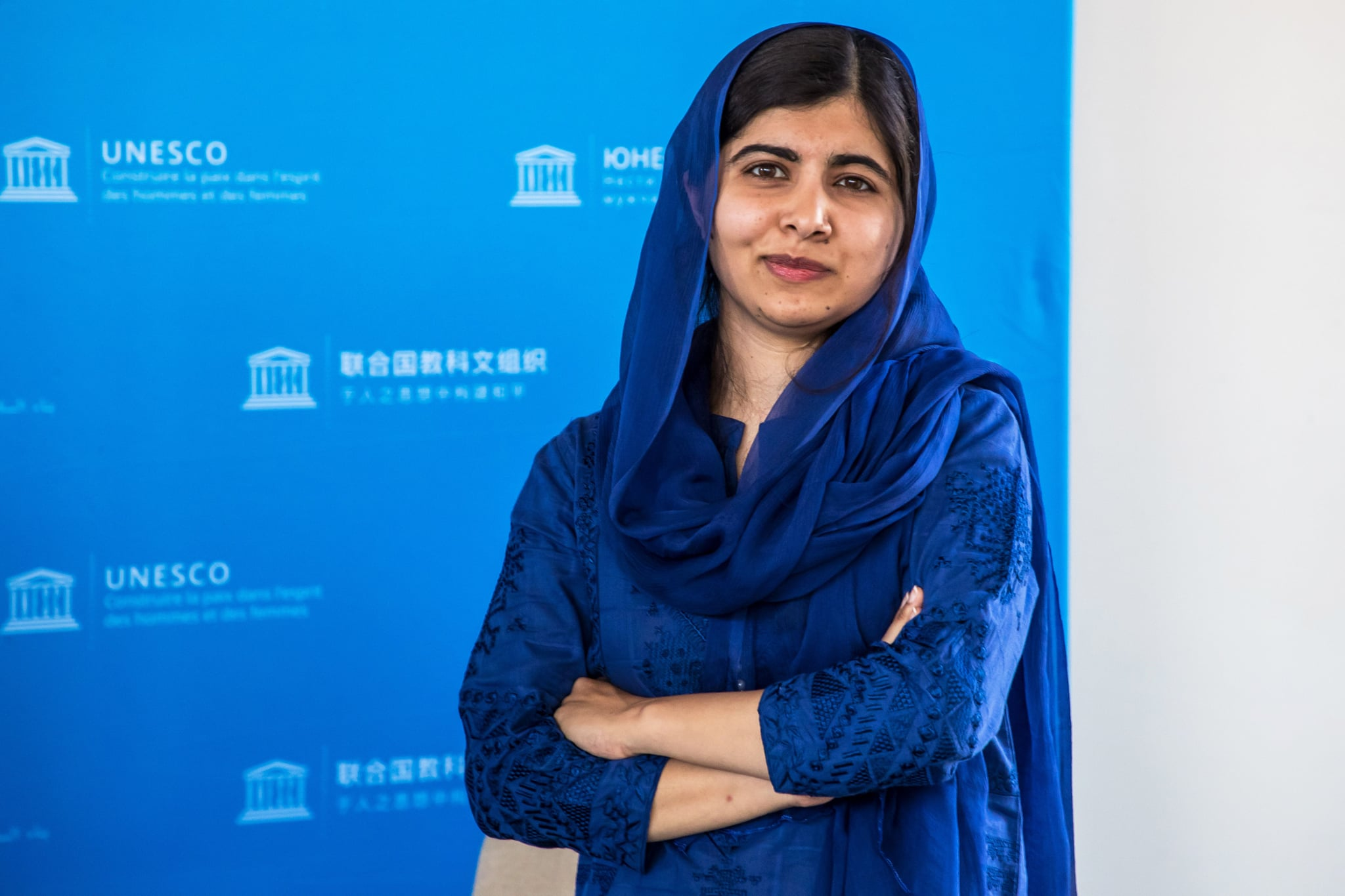 Nobel Peace Prize laureate Malala Yousafzai poses for photo session during the G7 Development and Education Ministers Meeting, in Paris, on July 5, 2019. - France is hosting the rotating presidency of the G7 in 2019. The 45th G7 Summit will be held in August 2019 in Biarritz. (Photo by Christophe PETIT TESSON / POOL / AFP)        (Photo credit should read CHRISTOPHE PETIT TESSON/AFP via Getty Images)