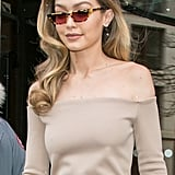Gigi wore her Gigi Hadid for Vogue Eyewear sunglasses as she exited a hotel in Paris, styled with a full Fendi outfit.