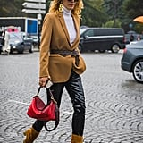 "Add all-American polish to your outfit with suede booties, a floppy brim hat, and a belted camel blazer. How ""Ralph Lauren"" of you."
