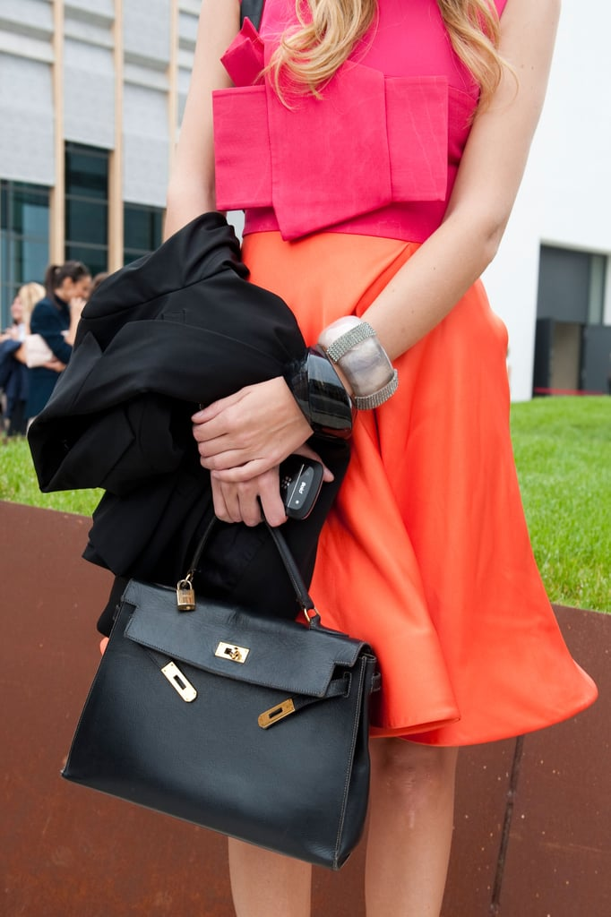 A black satchel tempered bold hues. Source: IMAXtree