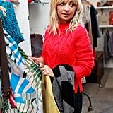 Nicole Richie in a red sweater.