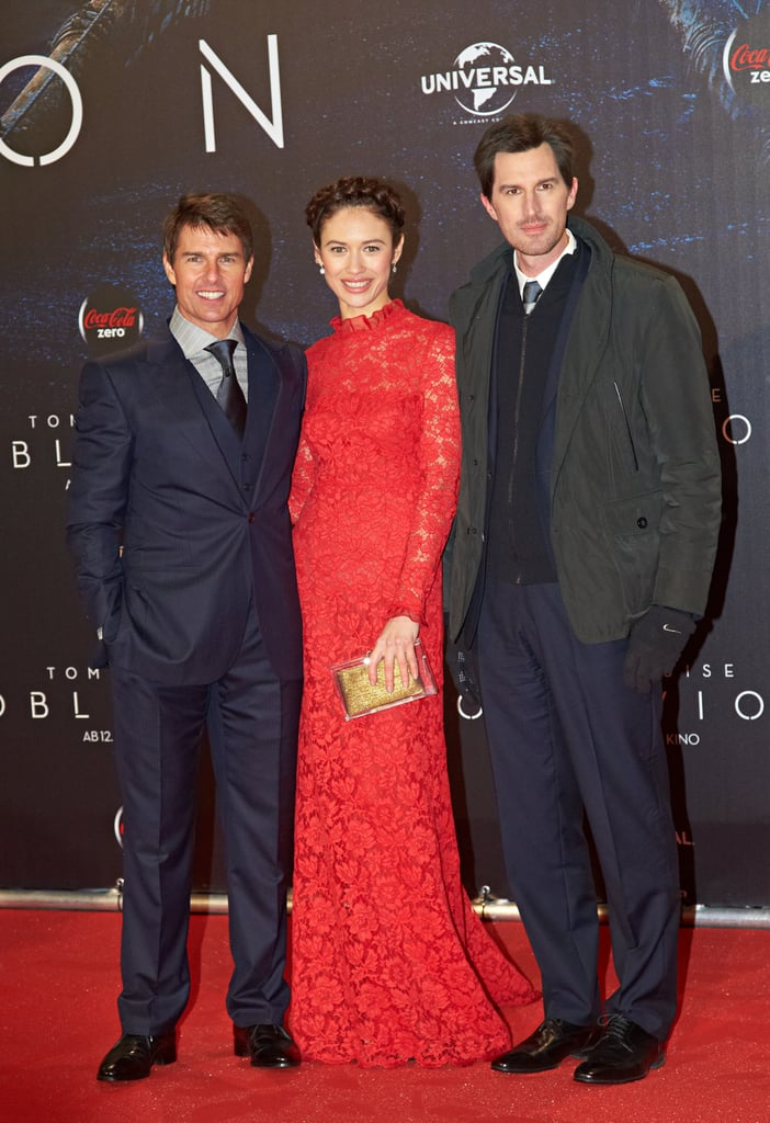 Tom Cruise, Olga Kurylenko, and director Joseph Kosinski posed together in Austria.