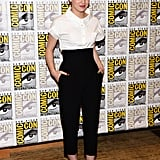 At a press conference for Ender's Game and Divergent, Hailee Steinfeld matched a crisp white shirt with high-waisted, cropped black trousers, both by Michael Kors, and a pair of Christian Louboutin flats.