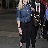 Reese Witherspoon proved the only thing you really need to make your travel style pop is a hint of red lipstick.