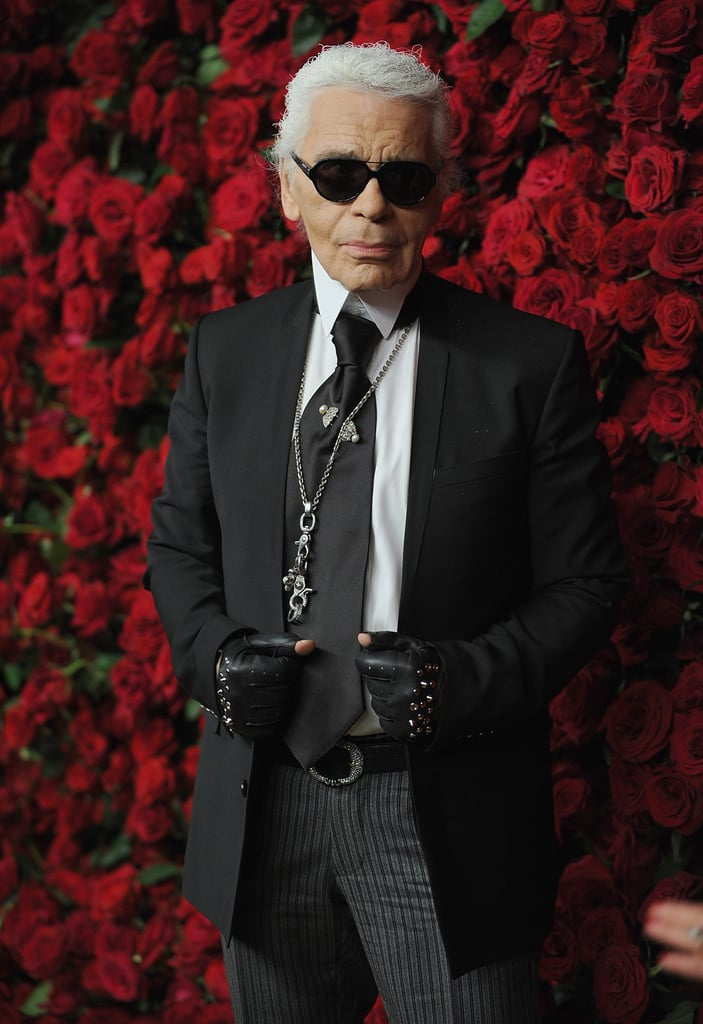 Karl Lagerfeld in a suit and tie to support Pedro Almodovar.
