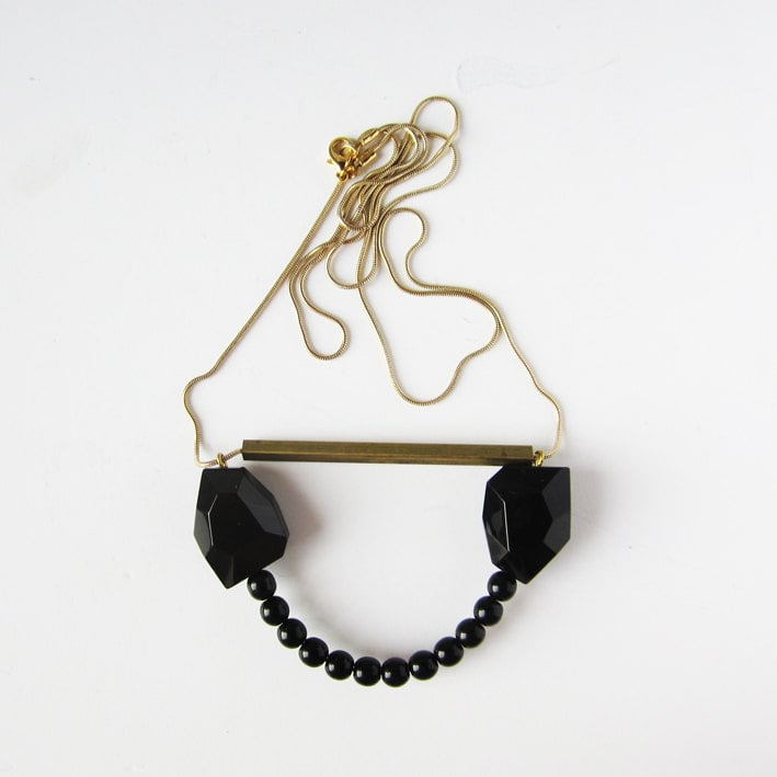 A handmade necklace is always a treat to unwrap — we suggest this Sew a Song Black Glass Necklace ($32), which was made in Barcelona.