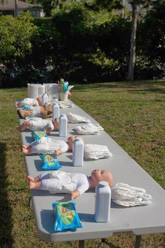 Diaper Changing Relay Race Baby Shower Games For Men Popsugar