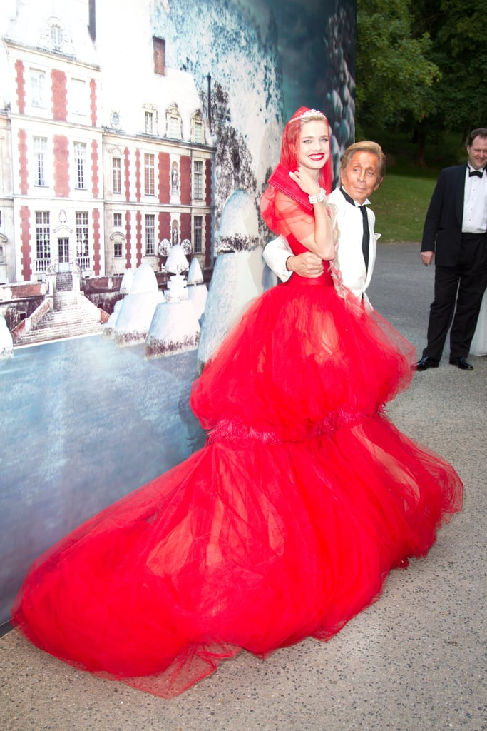 ">> To close out the Fall 2011 couture season, Natalia Vodianova invited a who's who of fashion to her White Fairy Tale Love Ball last night, hosted at Valentino Garavani's Chateau de Wideville estate on the outskirts of Paris. Her goal? To raise money for her Naked Heart Foundation, which has already built 60 playgrounds in 44 Russian cities. She succeeded in pulling in 2.3 million euros ($3.3 million) from the night, which included a fashion show featuring 45 custom dresses created by Olivier Theyskens, Alexander Wang, Stella McCartney, and every designer in between. Although the night's dress code called for white or silver gowns, Vodianova, for her part, wore a scarlet Little Red Riding Hood-inspired confection by Garavani himself — the first dress he has made since retiring in 2008. ""I always wear red to my events,"" Vodianova explained. A video from the festivities, below. <iframe width=""728"" height=""410"" src=""https://www.youtube.com/embed/Kw8JhEotgGs"" frameborder=""0"" allow=""accelerometer; autoplay; encrypted-media; gyroscope; picture-in-picture"" allowfullscreen=""""></iframe>"