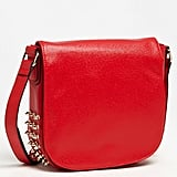 We dig the juxtaposition between the feminine red and tough silver spikes on this Nordstrom faux leather studded crossbody bag ($42). It would show-stop all day and all night.