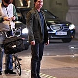 Tom Cruise brought his cheerful disposition to the set of Mission: Impossible 5 in London on Monday.