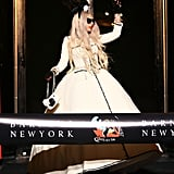 Lady Gaga waved to fans at Barneys New York.