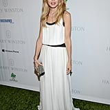 Rachel Zoe wore an effortless white maxi dress paired with a rhinestone-encrusted clutch.