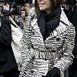 Carine Roitfeld tempered her animal-print coat with black Winter add-ons.