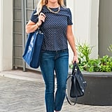 Reese is no denim-and-white-tee type of gal. The Southern star adds polish with neon patent leather heels.