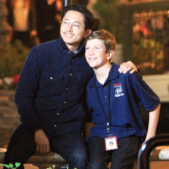Steven Yeun With Kid Reporter in LA December 2016