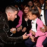 "Blue looked less than thrilled to meet Nick Jonas at the 2017 Grammys. Nick ended up poking fun at the moment on Instagram, writing, ""Caption this... 😂"""