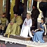 Tyrion (Peter Dinklage) and Daenerys (Emilia Clarke) observe with Missandei (Nathalie Emmanuel) and Daario (Michiel Huisman).