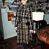 Jaime King bundled up in a plaid coat at a cocktail party in LA. Check out the leather accents and her slick studded booties.