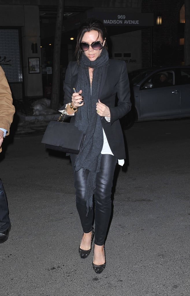 Victoria Beckham arrived in cold New York last night after flying out from Heathrow Airport. She added a scarf to her outfit, and also had a rather unique accessory. Her gold iPhone has a screensaver of shirtless David! She's in the US for Fashion Week and is model casting today before showing off her amazing new bags on Sunday.