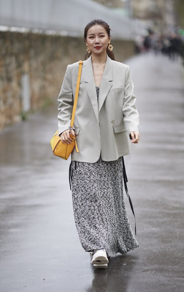 Give your floral slip dress a polished finish with the addition of a sleek gray blazer.