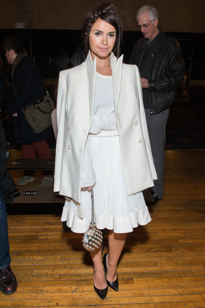 Miroslava Duma was all about white on white at the Philosophy by Natalie Ratabesi show. She worked her ladylike look with pointed black pumps for a dash of contrast.