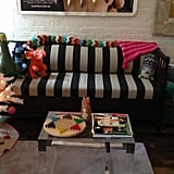 A mod couch is the perfect backdrop for a bright array of toys and games.
