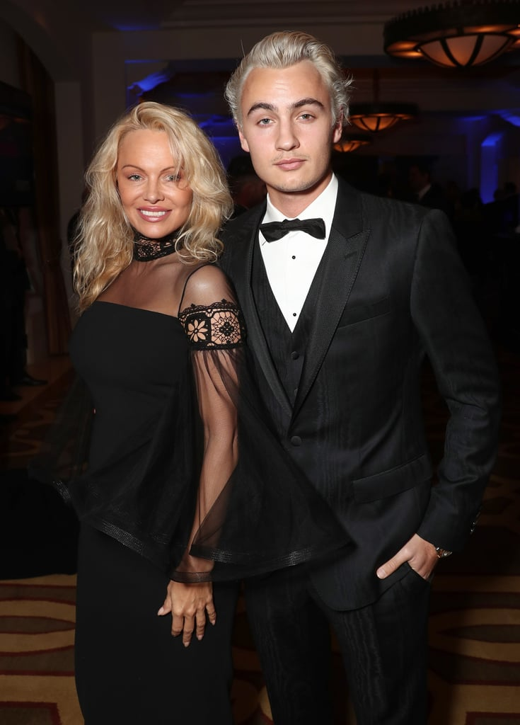 "Pamela Anderson certainly turned heads when she stepped out at Sean Penn's annual Haiti gala in Beverly Hills on Saturday night. In addition to looking gorgeous in a sexy black dress, the former Baywatch star was accompanied by her eldest son, 20-year-old Brandon Lee, whom she shares with ex-husband Tommy Lee. The mother-son duo stayed close as they posed for the cameras before linking up with other stars inside. During the event, Brandon snapped a smoldering selfie and posted it on Instagram, writing, ""Having more fun than my face portrays."" Good looks and a sense of humor? Check!      Related:                                                                Yep, Pamela Anderson's Son Just Keeps Getting Handsomer                                                                   Pamela Anderson Stuns on the Red Carpet With Her Handsome Son Dylan Lee"