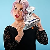 Kelly Osbourne showed off her award.