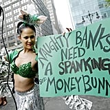 "A woman in New York dressed up as the ""Money Bunny"" held a sign that read ""Naughty banks need a spanking"" during a May Day labor rally."