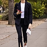 Vittoria Ceretti Wore a Pantsuit With Sneakers While Leaving the Chanel Show