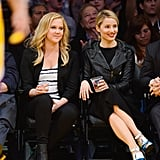 Dianna Agron and Amy Schumer sat courtside at a Lakers game in LA on Wednesday.