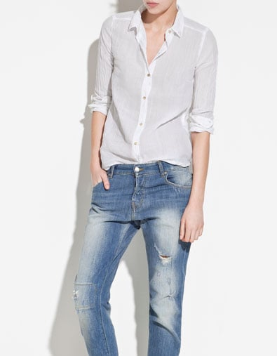 Everyone needs a basic white button-down, and the tiny studs on this one give it that extra something special.  Zara TRF Shirt With Studded Collar ($50)