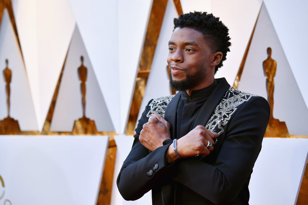 "Chadwick Boseman, also known as ""superhero bae,"" brought his good looks and his Wakanda pride to the 2018 Oscars. The 40-year-old Black Panther star and presenter at this year's show was mid-interview with ABC's Michael Strahan when he preached a loud ""Wakanda forever!,"" throwing his arms up in the film's signature badass gesture,  seen below.  A loud #WakandaForever from Chadwick Boseman on the #Oscars red carpet. #BlackPanther pic.twitter.com/WiEocdRQUs— Lights, Camera, Pod (@LightsCameraPod) March 4, 2018    It looks like Chadwick was inspired by his character T'Challa's wardrobe for his super classy and royal ensemble. In addition to shouting out during his interview, he threw up the nation's sign while numbing us with his handsome smirk on the red carpet. Read on to see Chadwick's photos at the Oscars and see why he's not only the king of Wakanda, but the king of award shows as well.      Related:                                                                                                           Every Dress That Came Down the Oscars Red Carpet Was Undeniably Captivating"
