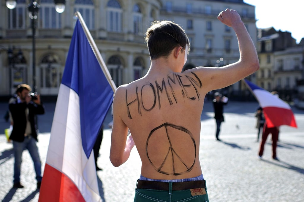 A shirtless anti-gay-marriage protester demonstrated in Paris before the law passed.