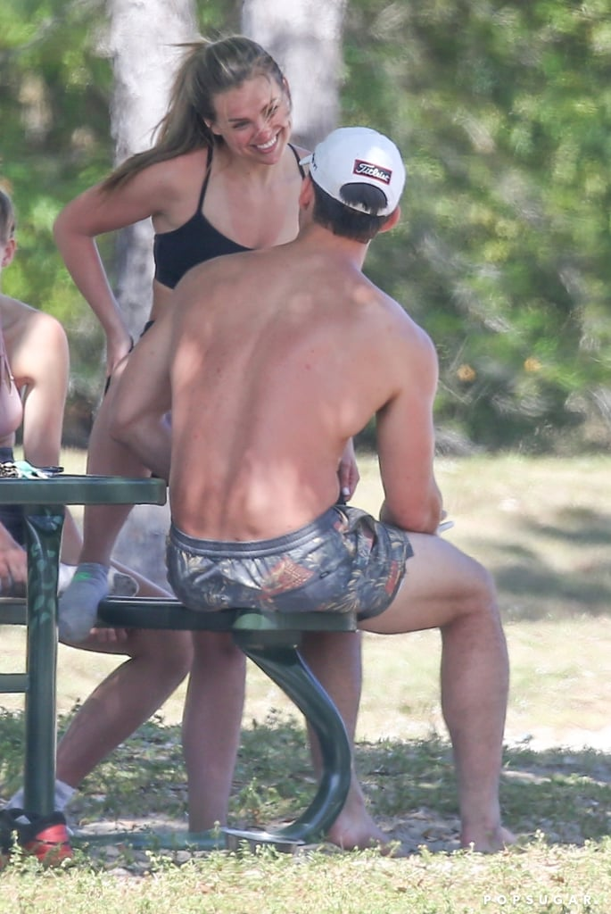 "Tyler Cameron is leaning on Hannah Brown following the death of his mom, Andrea. Over the weekend, the 27-year-old model was spotted picking up the 25-year-old former Bachelorette from the airport in Florida, and on Monday, the two hit up the beach for a little fun in the sun with a group of friends. Hannah slipped into a white bikini, and Tyler went shirtless as they played a round of volleyball and went for a dip in the ocean. They even created a TikTok account with their friends called The Quarantine Crew. In one clip, the group of four guys and four girls dance to Megan Thee Stallion's song ""Savage"" in their swimsuits. The following day, Hannah and Tyler got their sweat on during a group workout session. Tyler was famously runner-up on Hannah's season of The Bachelorette, losing out to musician Jed Wyatt. However, the two have remained close since then, and they even went out on a date after she broke off her engagement to Jed.  Tyler's mom died of a brain aneurysm in late February. She was 55. According to E! News, Hannah and Tyler are not dating, but she has been there for Tyler as he grieves. ""She reached out immediately, and Tyler was grateful for her support. They have gotten closer recently, and he's really thankful to have her around,"" a source told the outlet. ""Hannah knew his mother, and it's comforting to him to have her support and be around him and his family.""  Hannah's dad, Robert, also recently weighed in on the relationship rumors when he commented on a photo of the two on Instagram, writing, ""These two do get along very well together."" Hmm . . . . See more of Hannah and Tyler's outings ahead.       Related:                                                                                                           Surprise! Tyler Cameron's BFF Matt James Will Be on Clare's Season of The Bachelorette"