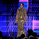 Tracee captivated us in a long-sleeved, metallic mirrored gown.