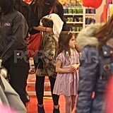 Katie Holmes and Suri Cruise checked out toys at a toy store.