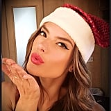 Alessandra Ambrosio blew a kiss to her fans while getting into the holiday spirit with a sparkly Santa hat. Source: Instagram user alessandraambrosio