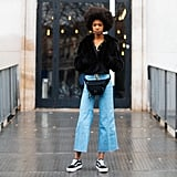 With a Cropped Fur Jacket, Fanny Pack, and Flared Jeans