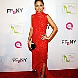 Nicole Richie wore a bright red dress with a high neckline on the carpet.