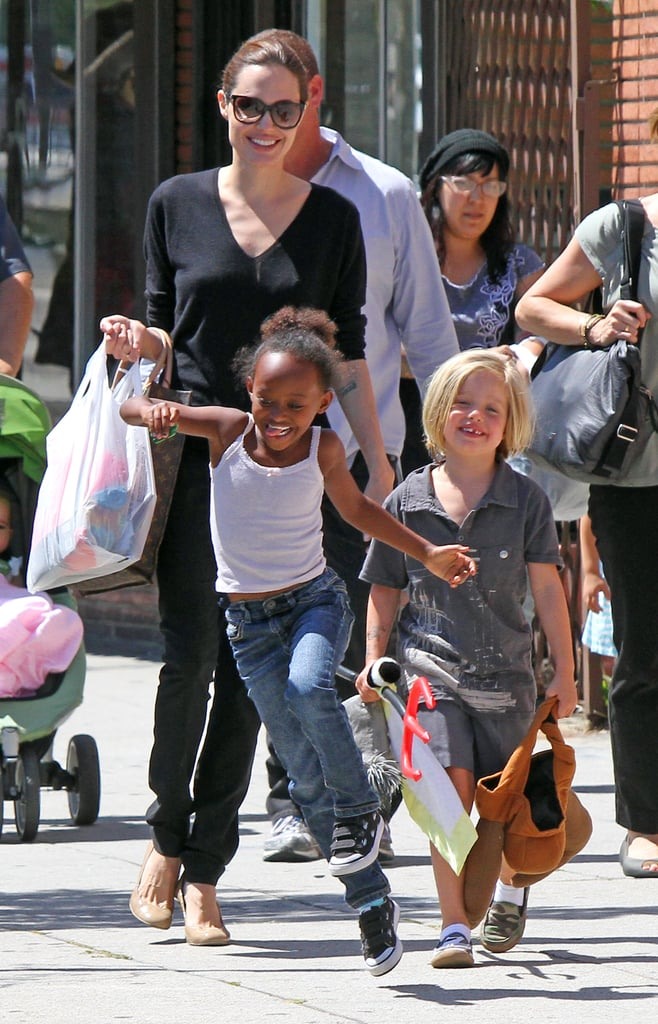 Shiloh Jolie-Pitt and Zahara Jolie-Pitt shop with Angelina Jolie.