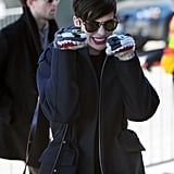 Anne Hathaway had fun with her puppy mittens on Monday at Sundance.