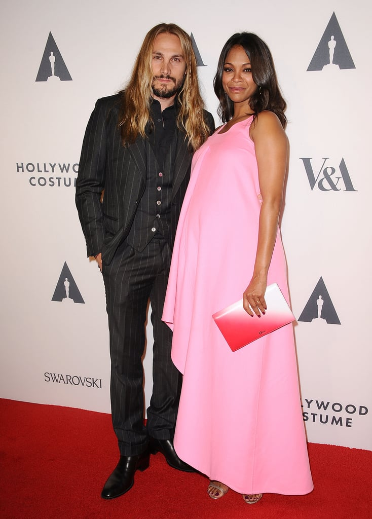 "Zoe Saldana confirmed the news that she's having twins when she brought her baby bump to the Academy of Motion Picture Arts and Sciences' Hollywood Costume exhibit in LA on Wednesday night. The actress, who was joined on the red carpet by her artist husband, Marco Perego, let the twin news slip when she was asked if she would be dressing up for Halloween this year. Zoe said, ""I might. I might need three costumes. I might have to make some adjustments, but it would be nice."" She also joked that she might go as a bride, saying it would be ""a shotgun wedding"" theme. News of Zoe's pregnancy first surfaced back in July while she was on a promotional tour for her hit Marvel film, Guardians of the Galaxy. At the time, there was speculation that Zoe was expecting twins, but the private actress didn't confirm the news until this month."