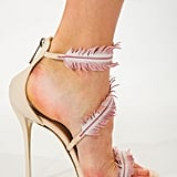 Oscar de la Renta dazzled with feather-trimmed heels.