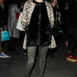 Olivia makes two bold statement pieces, like her Tibi leopard coat and black fur vest work with the right balance. A pair of netural army-green skinnies balance out proportions and standout pattern, while a pair of fringe-adorned Christian Louboutin booties lend that same touch of style power to finish off the look with the right vibe at Matthew Williamson.