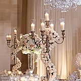 Add even more glamour to a candelabra centerpiece with roses twisting around it.