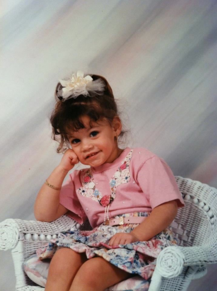 """""""Baby Maria was 3 years old. Mom brought a photographer to the house for some photos and decked me out in matching florals and gold jewelry. The finishing touch? A tulle barrette. Because why not, right?"""" —  Maria Del Russo, editorial assistant, POPSUGAR Beauty"""