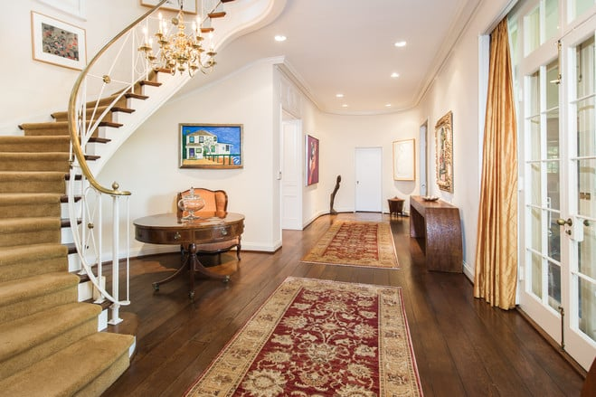 A Curved Staircase Leads To The Grand Master Bedroom.